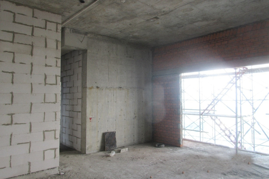 Construction of brick wall at level 39
